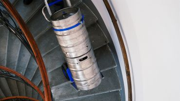 Liftkar SAL Ergo stairclimber with beer barrels on curved stair